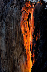 Backlit Horsetail Fall plunges from El Capitan
