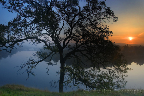 Sun rises above Lake Natoma.