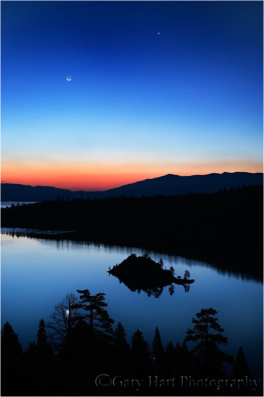 Crescent moon in the pre-dawn sky above Lake Tahoe