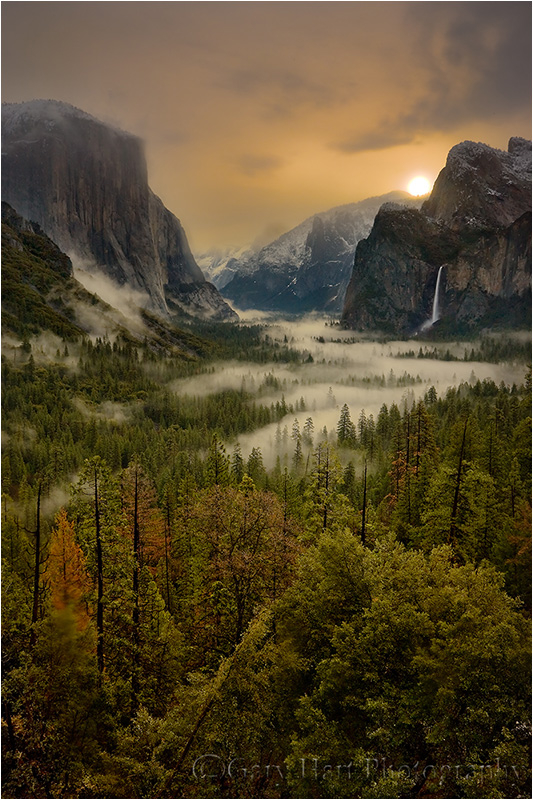 Sun burns  a hole in the clouds above Yosemite.