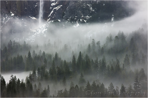 Mist swirls around the base of Bridalveil Fall.
