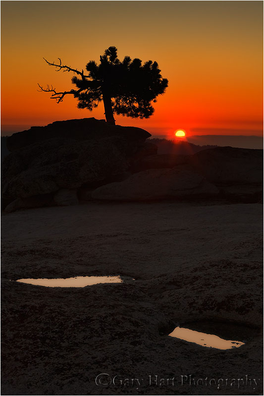Pools reflect sunset atop Sentinel Dome