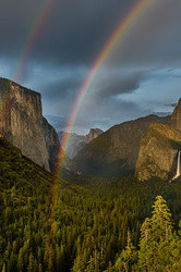 Double rainbow arcs over Yosemite Valley