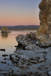 Moon rises above Mono Lake at sunset