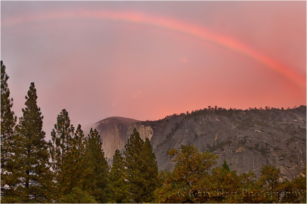 Rainbow and red sky above Half Dome