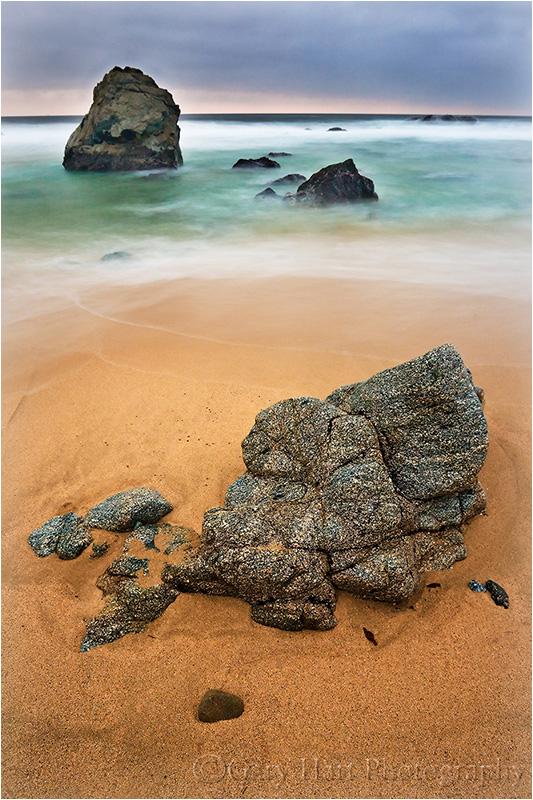 Rocks and surf at twilight