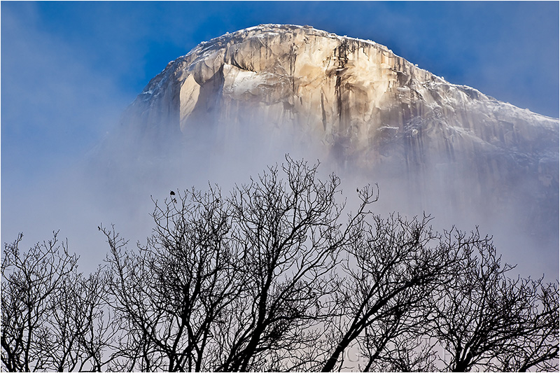 El Capitan emerges from the clouds