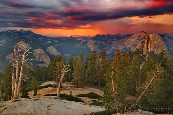Crimson sunset bathes Sentinel Dome and Half Dome