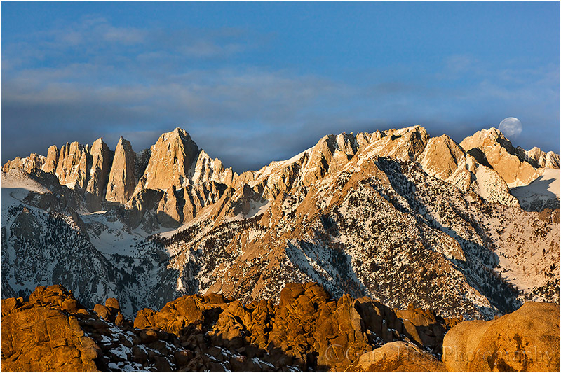 Moon setting behind a snowy Mt. Whitney
