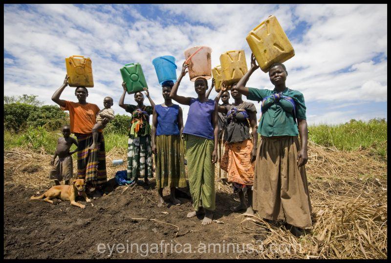 African Women Carrying Water