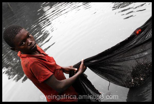 Boy in Uganda fishing