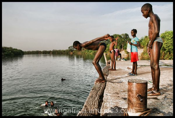 Kids Swimming In The Gambia River
