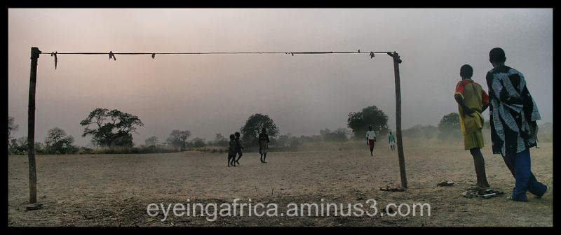 Gambian Kids Playing Football On A Dirt Field