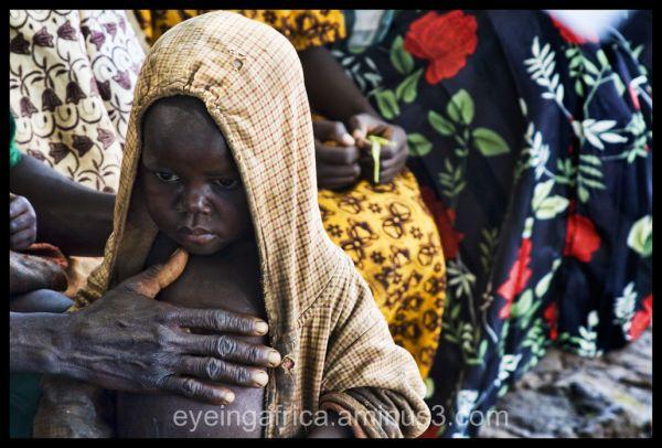Ugandan Mother and Child At HIV Testing