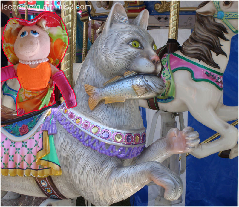 Ms Piggy rides merry-go-round