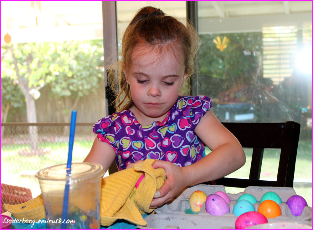 Grace coloring Easter eggs