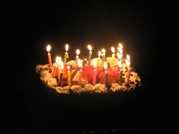 Candles, strawberries and cake