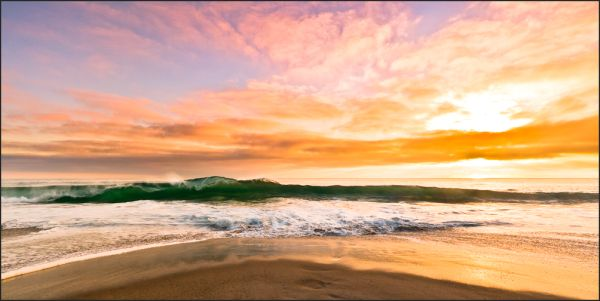 sunset at Laguna Beach with breaking wave