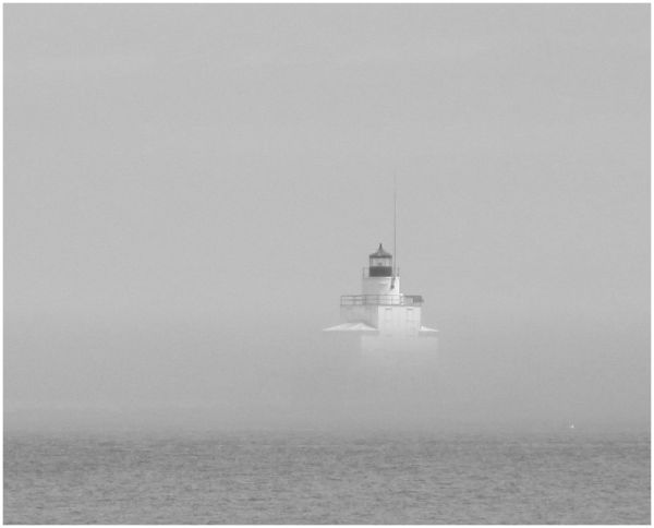 lighthouse in the midday fog