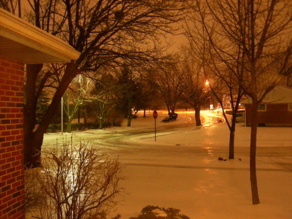 Predawn ice covered roadway