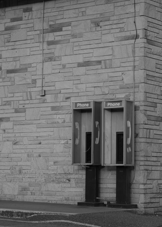 empty phone booths at abandoned site
