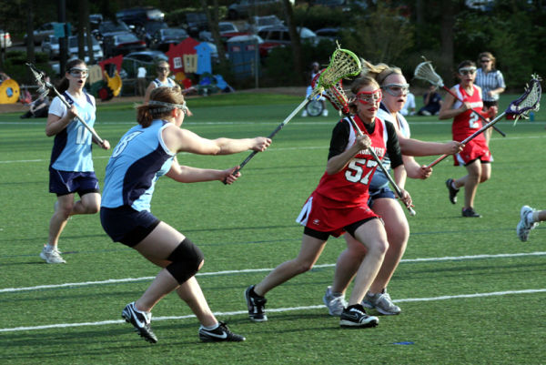 girls lacrosse defense at the goal
