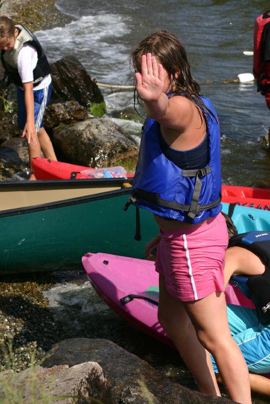 a young girl at kayak camp