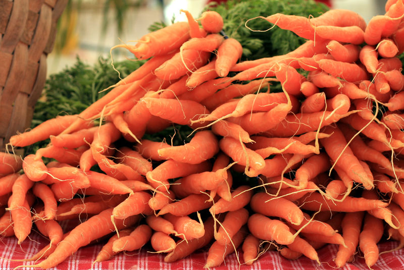 bundles of carrots at a farmers market