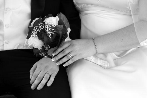 bride and groom wedding hands