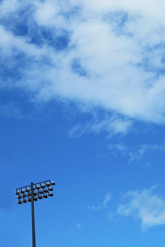lights at husky stadium against a blue sky
