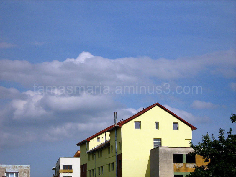 Blue sky above a yellow building