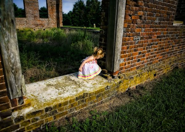 child kneeling at the wall