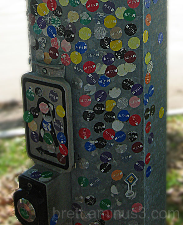 A lightpost with MFA stickers on it