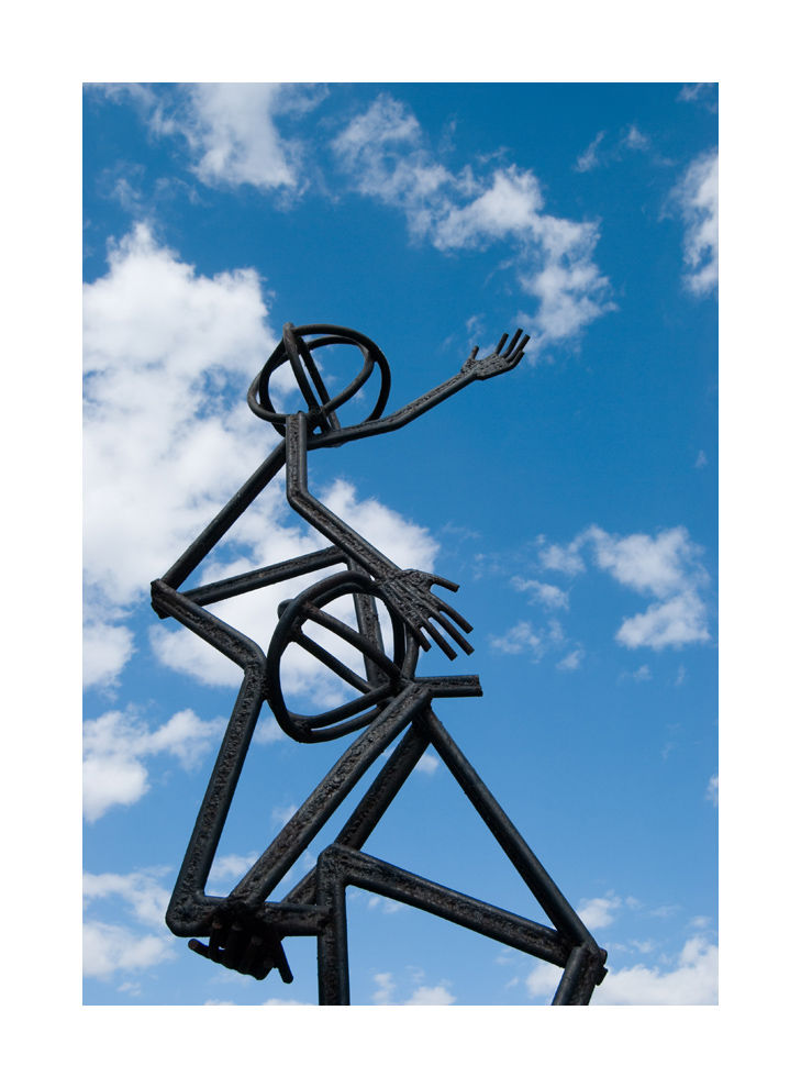 A picture of a metal sculpture reaching the sky