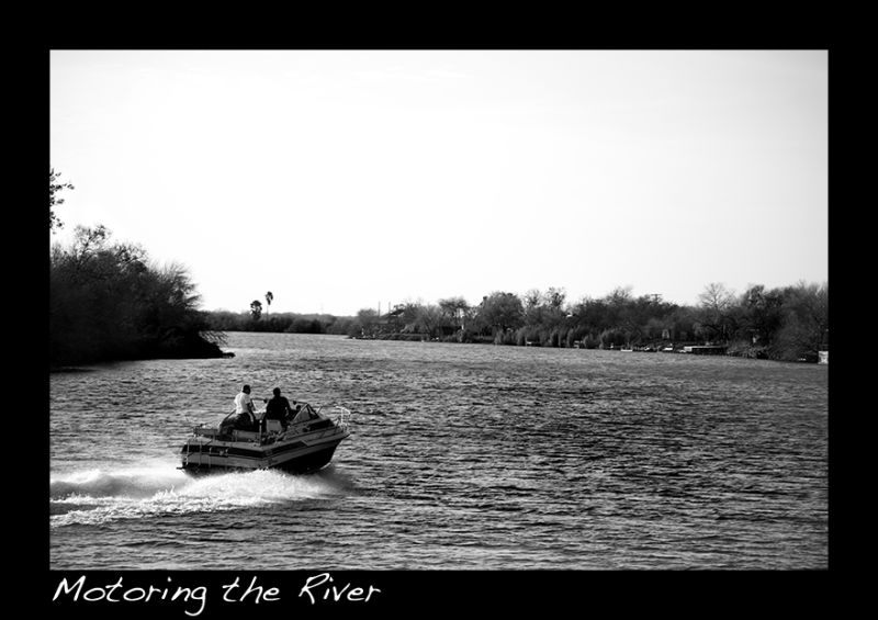 A picture of a boat on the river