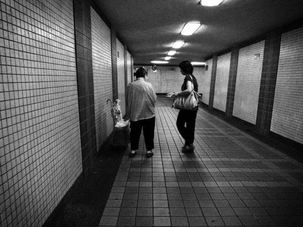 The old lady who hands out leaflet in a tunnel