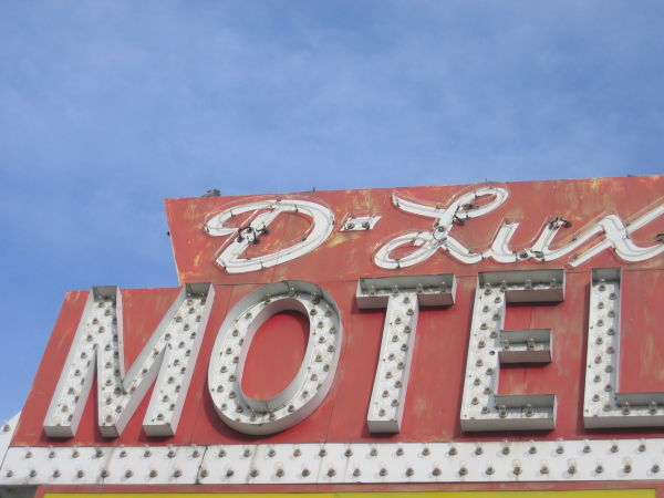 Motel sign in bright daylight.