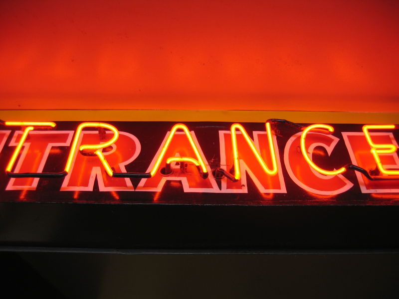 a trance-inducing neon entrance sign