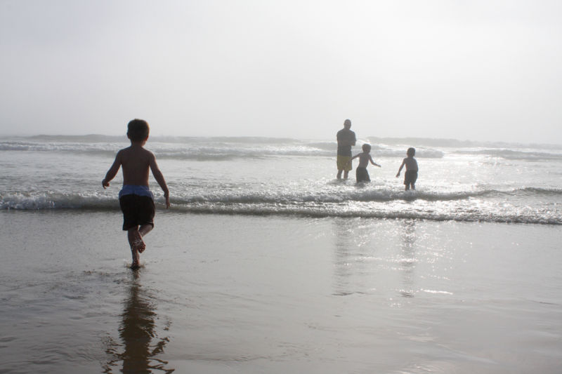 ian running into the surf at newport beach