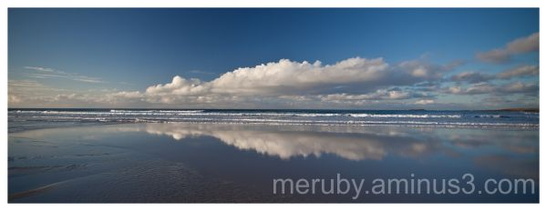 Mirroring clouds at Kilchoman Beach