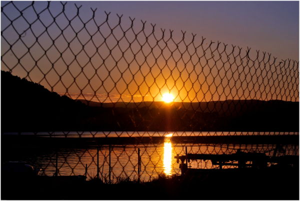 Sunset through a fence