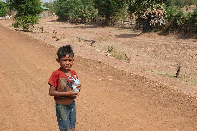 a young boy walking in the country