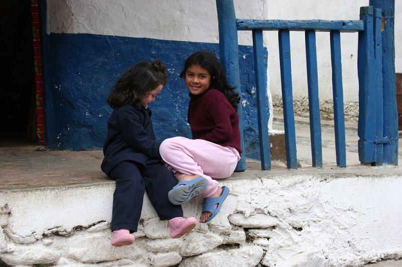 two lovely children in a little village