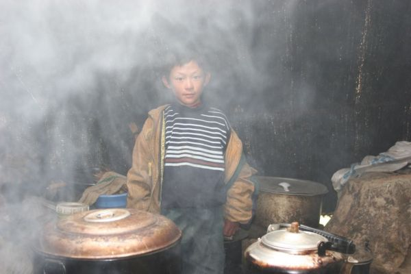 young tibetan nomad in his tent house