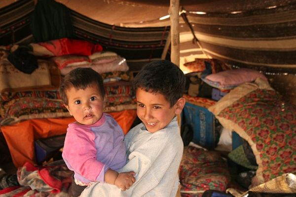 beduins children under their tent in the desert