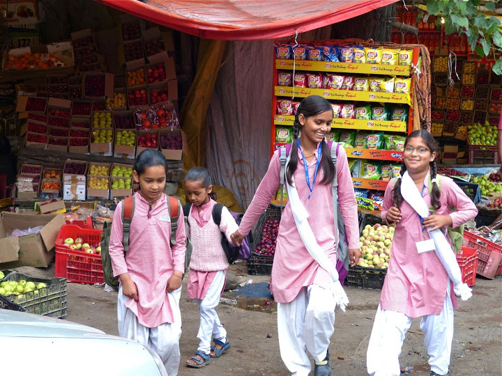 young ladies  at fruit market