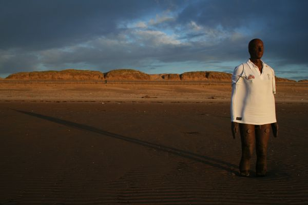 Anthony Gormley's Another Place statue at Crosby