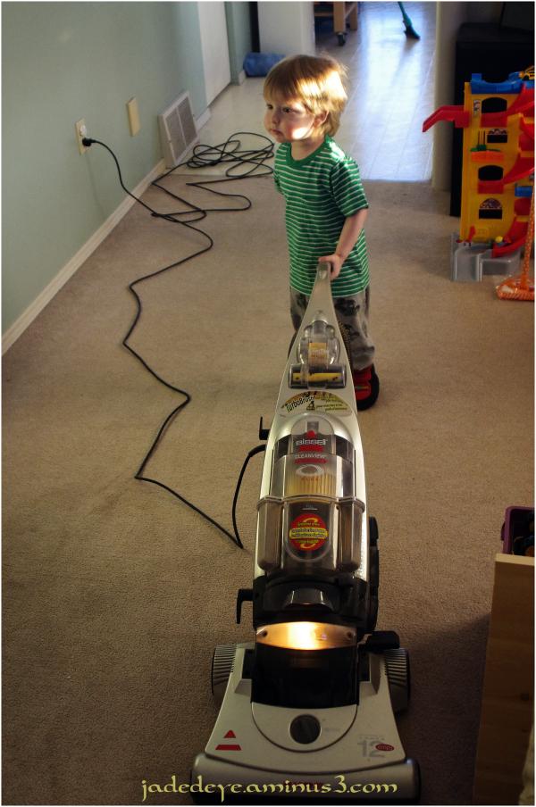 He Vacuums