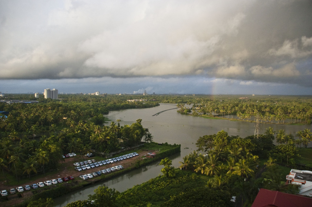 Rainbow over river, cloudy day, view from above