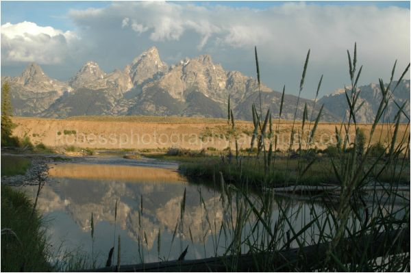 Tetons at sunrise with river in foreground